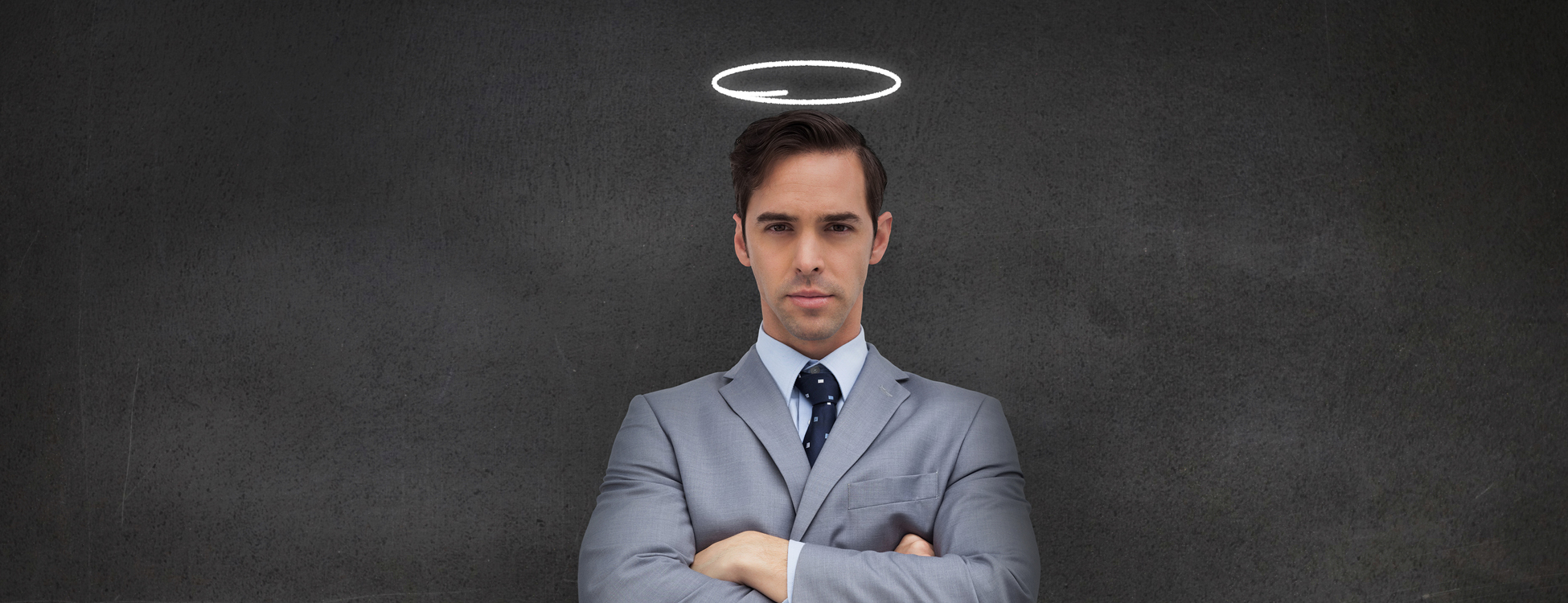 Businessman representing an angel and standing with arms crossed